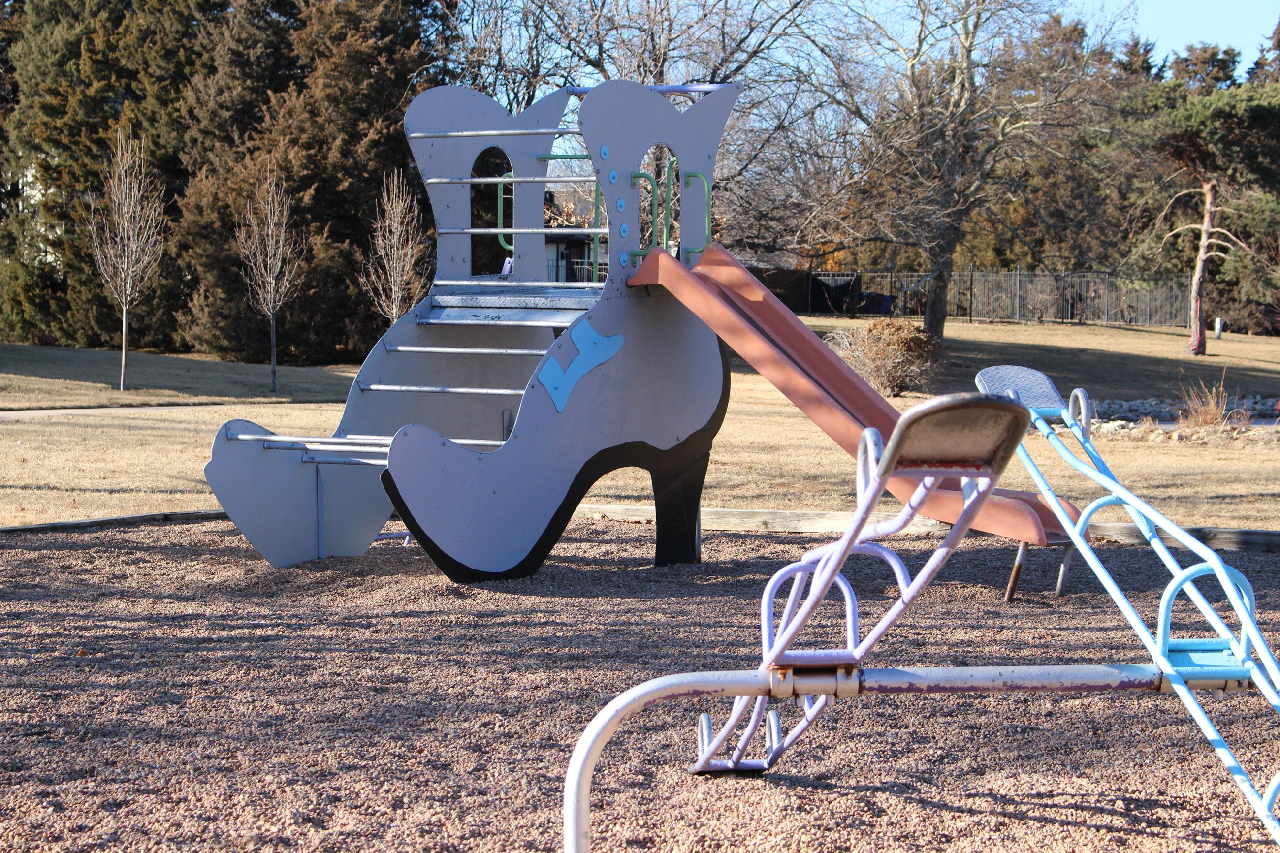 Countryside Park features a slide that looks like a shoe, which sits next to a merry-go-round