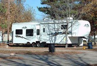 A camper is parked on the grounds of an RV park.