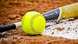 Yellow softball laying on the ground next to a bat