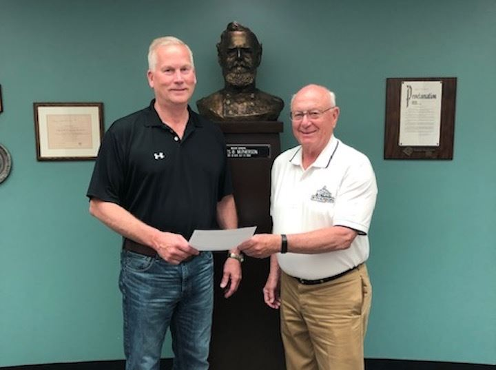 Businessman presenting a donation check to the Mayor of McPherson, Kansas