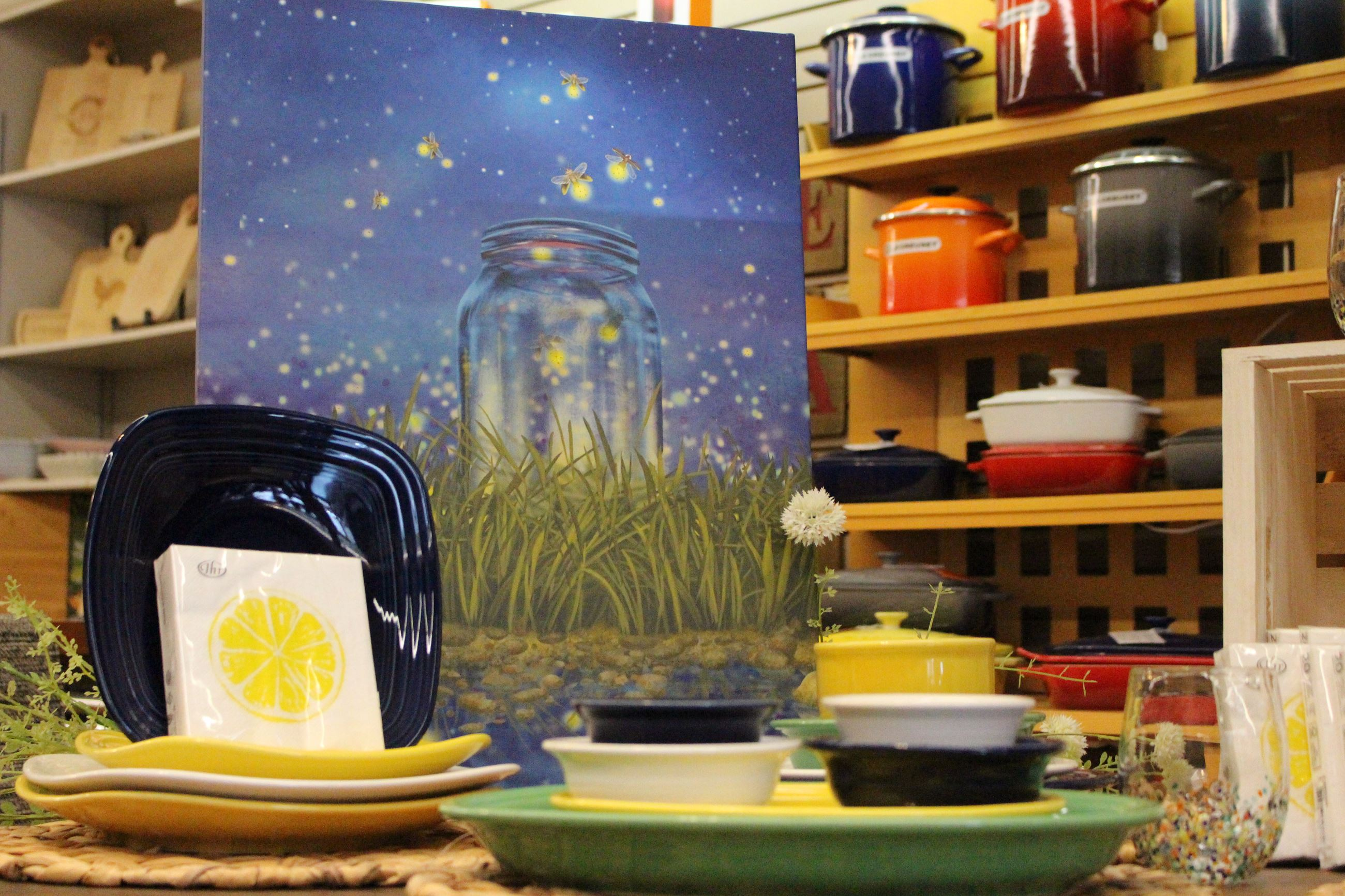 Colorful dishware on display in a cooking store