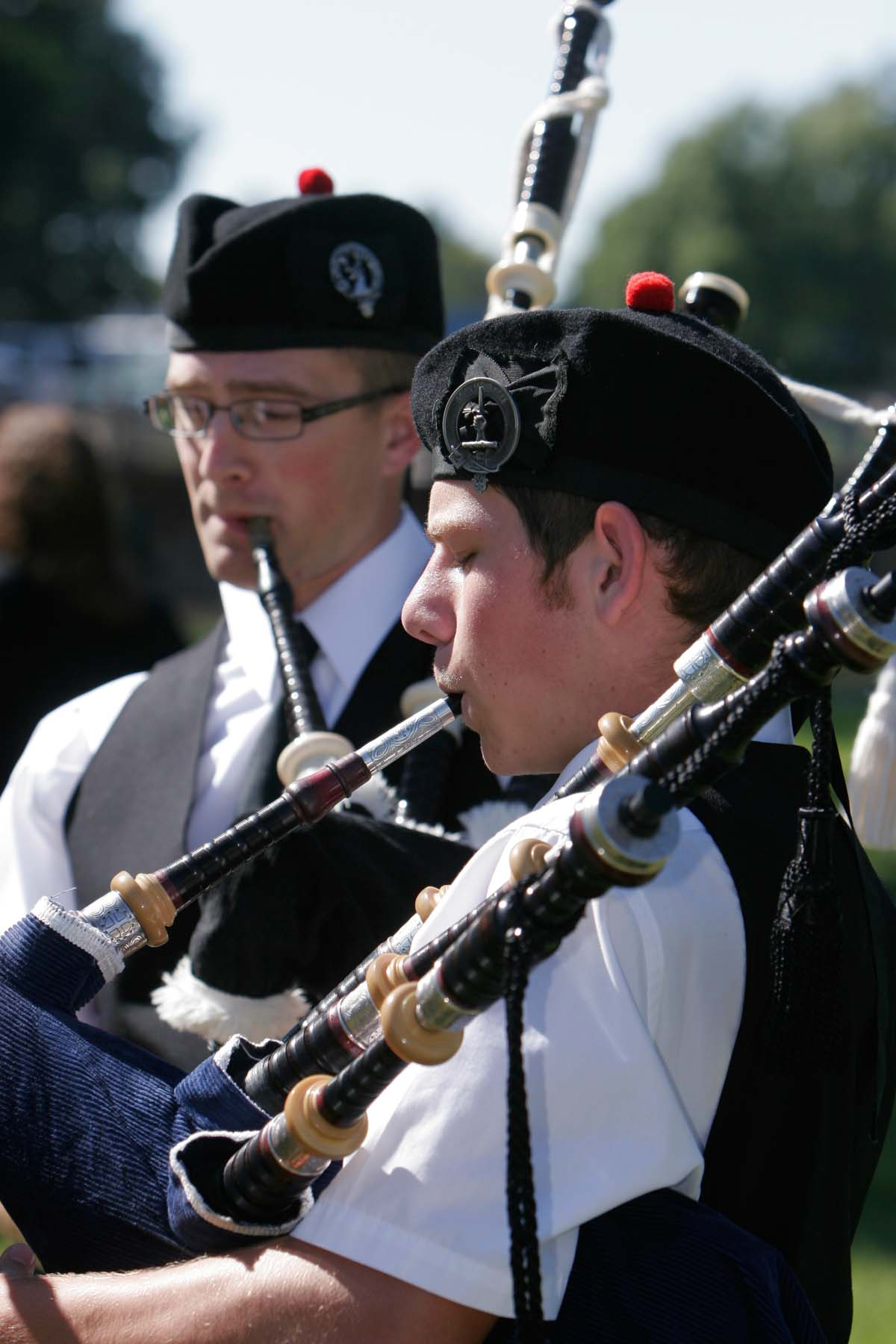 Men playing bagpipes.